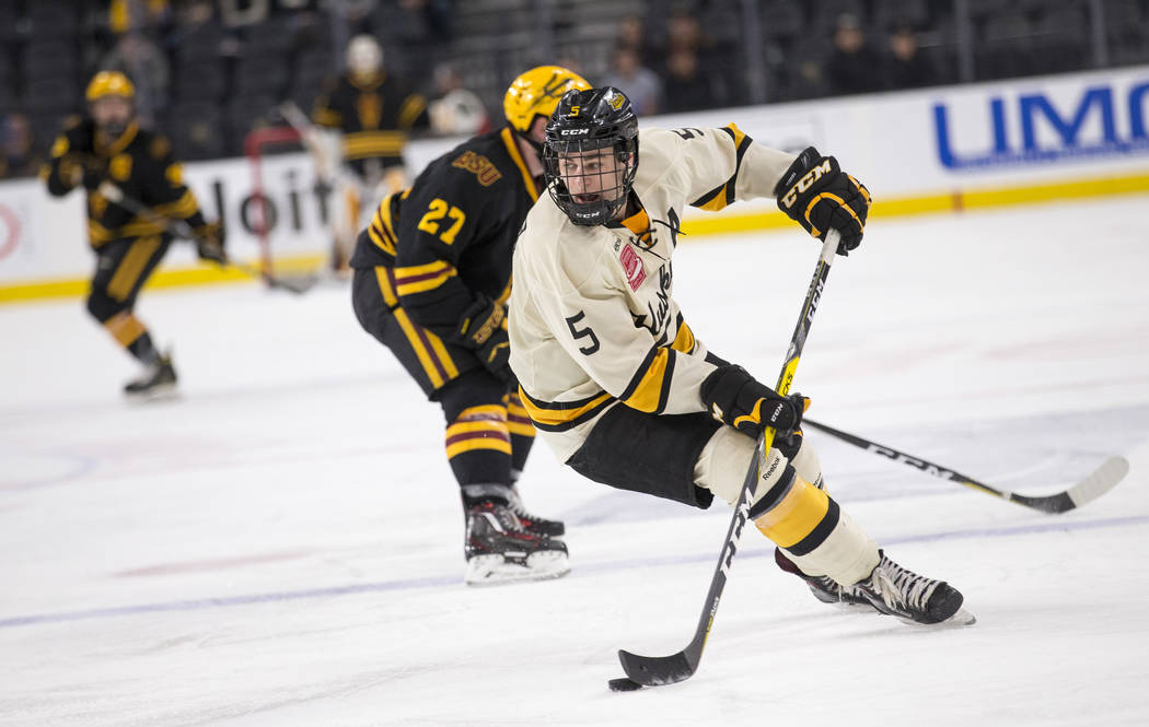Michigan Tech Huskies defenseman Mitch Reinke (5) controls the puck against Arizona State Sun Devils during the inaugural Ice Vegas Invitational college hockey tournament at T-Mobile Arena in Las  ...
