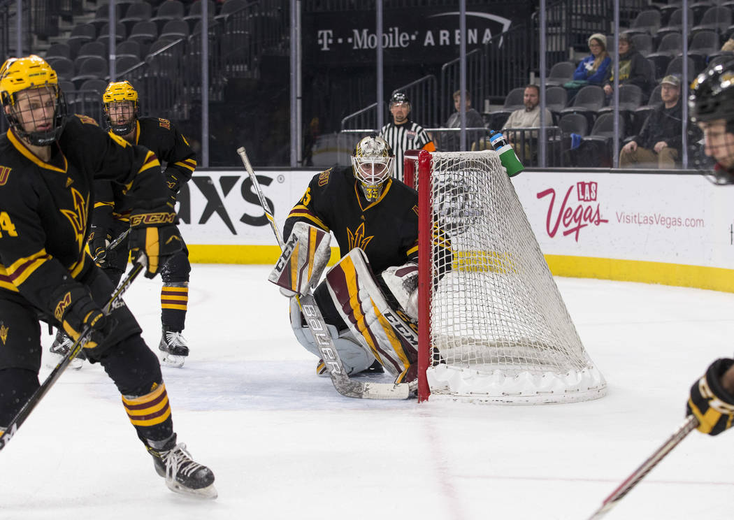 Arizona State Sun Devils goaltender Joey Daccord (35) keeps an eye on the puck against the Michigan Tech Huskies during the inaugural Ice Vegas Invitational college hockey tournament at T-Mobile A ...