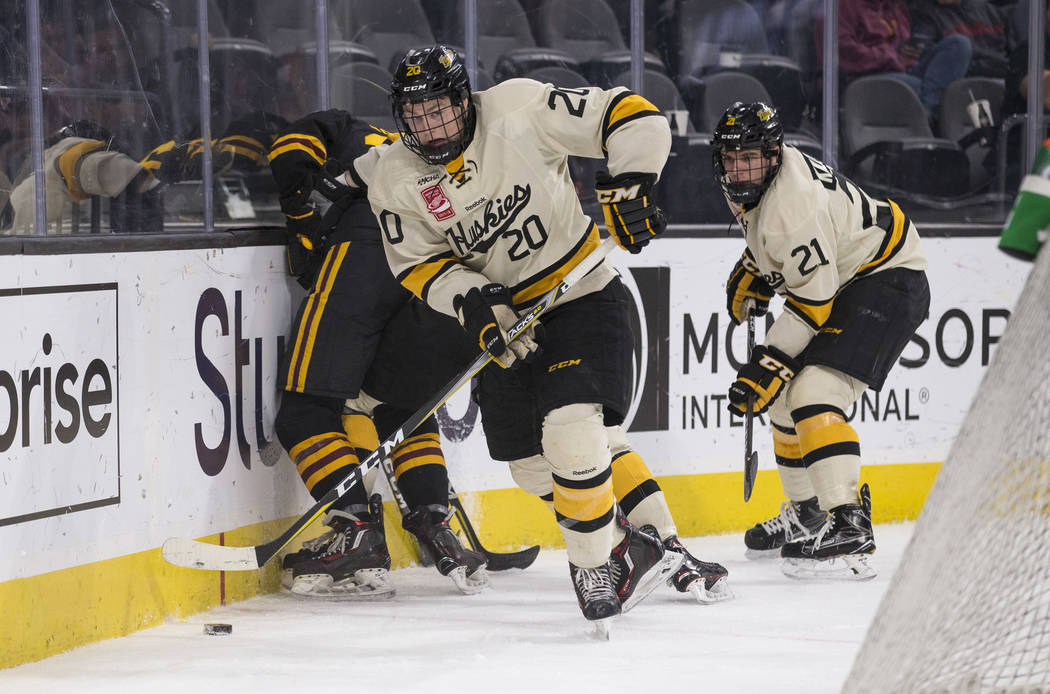 Michigan Tech Huskies forward Alex Smith (20) controls the puck against the Arizona State Sun Devils during the inaugural Ice Vegas Invitational college hockey tournament at T-Mobile Arena in Las  ...