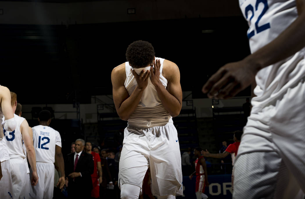 Air Force forward Ryan Swan (34) puts his head in his hands following the team's loss to UNLV during an NCAA college basketball game at Air Force Academy, Colo., Wednesday, Jan. 10, 2018. (Dougal  ...