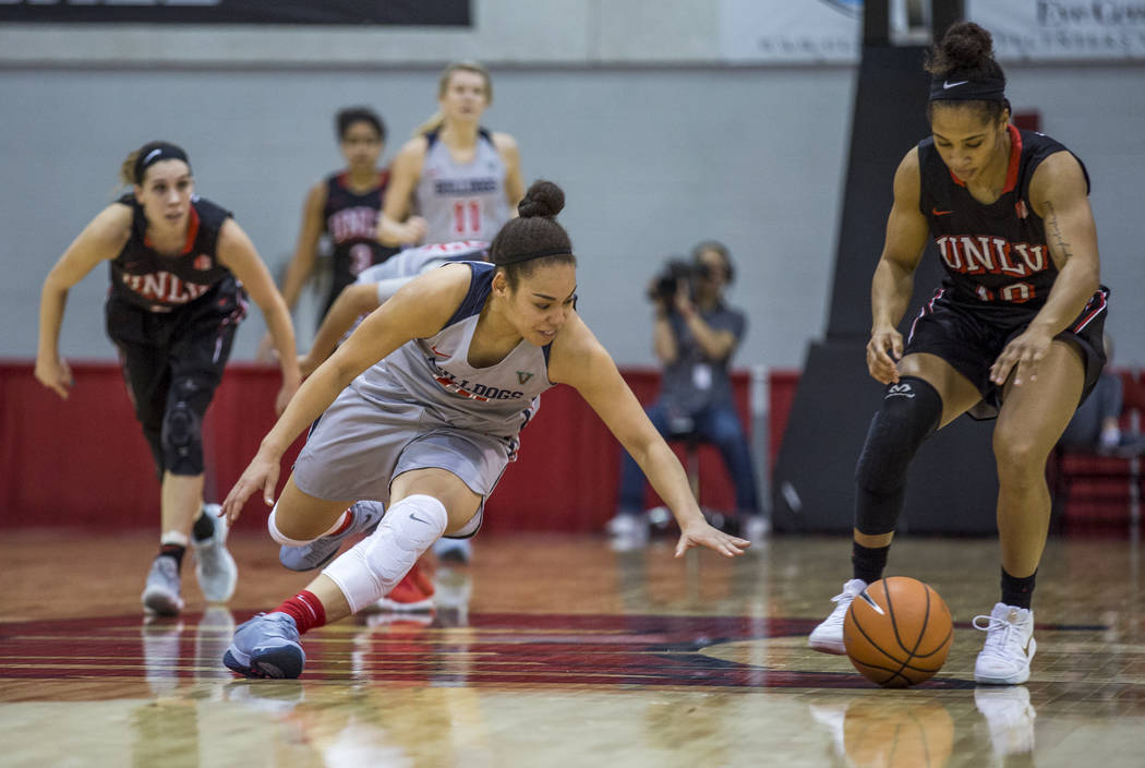 Fresno State's Candice White (10) goes after a loose ball while UNLV guard Nikki Wheatley (10) does the same at Cox Arena in Las Vegas on Wednesday, Jan. 24, 2018. Fresno State won 74-72.  Patrick ...