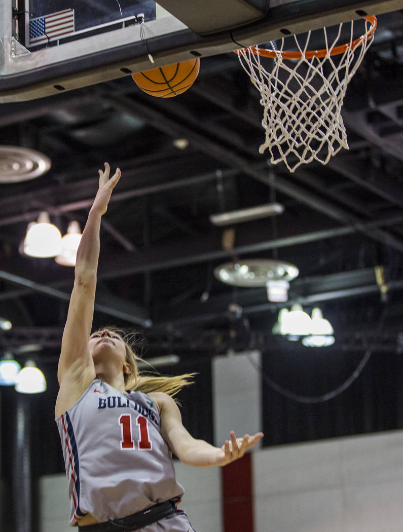 Fresno State's Maddi Utti (11) goes up for a shot while playing the UNLV Lady Rebels at Cox Arena in Las Vegas on Wednesday, Jan. 24, 2018. Fresno State won 74-72.  Patrick Connolly Las Vegas Revi ...