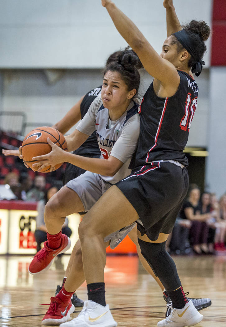 Fresno State's Aly Gamez (22) tries to dribble around UNLV's Nikki Wheatley (10) at Cox Arena in Las Vegas on Wednesday, Jan. 24, 2018. Fresno State won 74-72.  Patrick Connolly Las Vegas Review-J ...