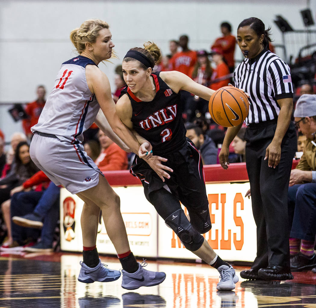UNLV's Brooke Johnson (2) dribbles around Fresno State's Maddi Utti (11) at Cox Arena in Las Vegas on Wednesday, Jan. 24, 2018. Fresno State won 74-72.  Patrick Connolly Las Vegas Review-Journal @ ...