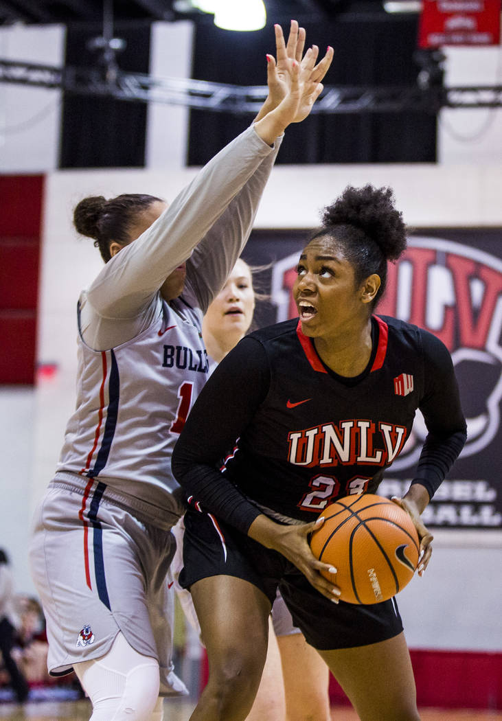 UNLV's Jordyn Bell (23) looks for a shot while Fresno State's Jordanna Porter (14) tries to block her at Cox Arena in Las Vegas on Wednesday, Jan. 24, 2018. Fresno State won 74-72.  Patrick Connol ...