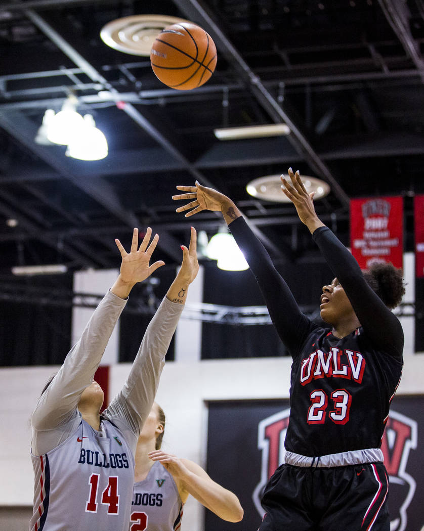 UNLV's Jordyn Bell (23) shoots while Fresno State's Jordanna Porter (14) tries to block her at Cox Arena in Las Vegas on Wednesday, Jan. 24, 2018. Fresno State won 74-72.  Patrick Connolly Las Veg ...