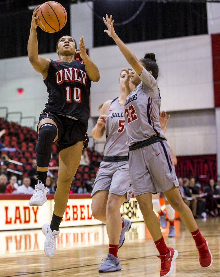 UNLV's Nikki Wheatley (10) goes up for a shot while Fresno State's Aly Gamez (22) and Katelin Noyer (5) try to block her at Cox Arena in Las Vegas on Wednesday, Jan. 24, 2018. Fresno State won 74- ...