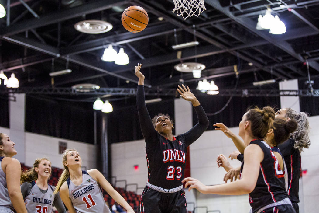 UNLV's Jordyn Bell (23) loses control of the ball while Alyssa Anderson (20) and Katie Powell (21) wait for the rebound along with Fresno State's Breanne Knishka (13), Kristina Cavey (30), Maddi U ...