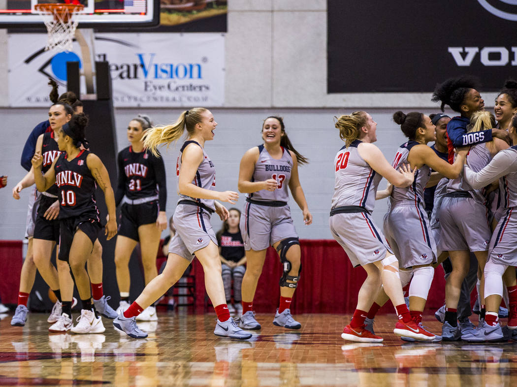Fresno State players celebrate after a narrow victory against the UNLV Lady Rebels at Cox Arena in Las Vegas on Wednesday, Jan. 24, 2018. Fresno State won 74-72.  Patrick Connolly Las Vegas Review ...