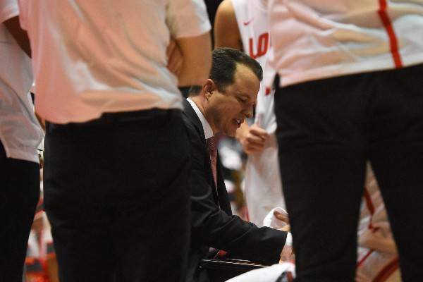 New Mexico basketball coach Paul Weir diagrams a play. Photo courtesy of University of New Mexico athletics.