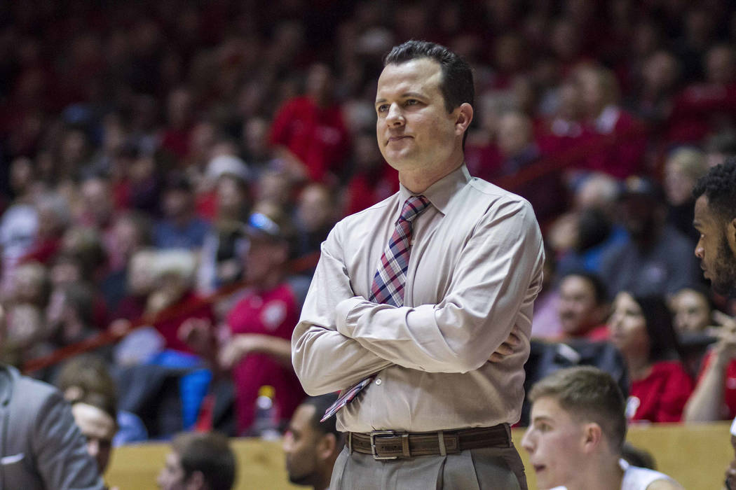 New Mexico coach Paul Weir reacts to a missed shot during the second half of the team's NCAA college basketball game against New Mexico State in Albuquerque, N.M., Saturday, Dec. 9, 2017. New Mexi ...