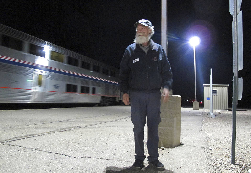 In this Friday, Dec. 29, 2017 photo, Len Daley waits for the last passengers from an Amtrak train at Williams Junction to board shuttles to nearby Williams, Ariz. Shuttle service between the junct ...