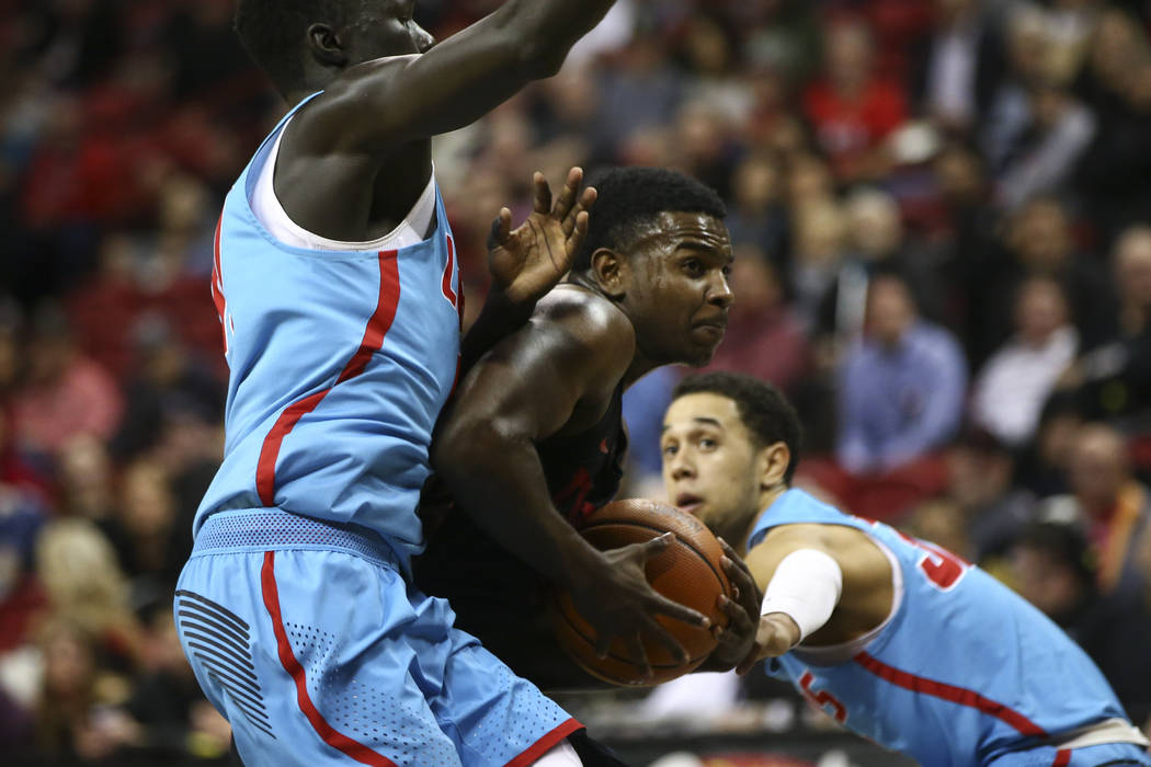New Mexico Lobos guard Makuach Maluach (10) and New Mexico Lobos guard Antino Jackson (3) UNLV Rebels guard Amauri Hardy (3) during a basketball game at Thomas & Mack Center in Las Vegas on We ...