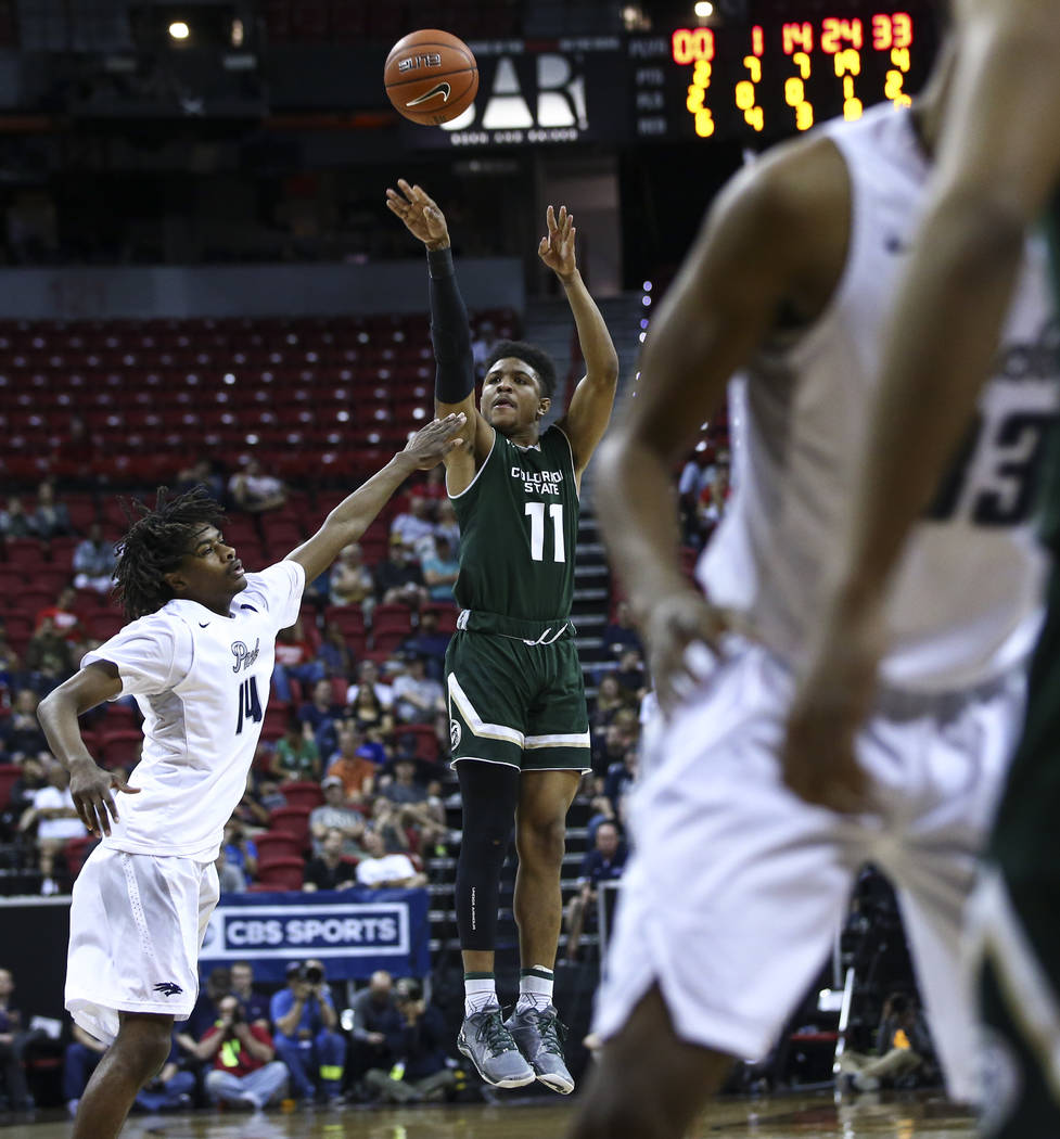 Colorado State guard Prentiss Nixon (11) shoots over UNR guard Lindsey Drew (14) during the Mountain West Conference basketball championship game at the Thomas & Mack Center in Las Vegas on Sa ...