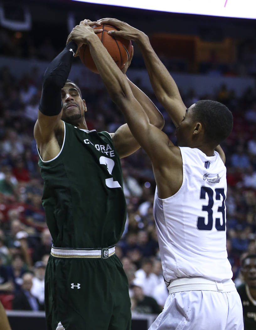 UNR guard Josh Hall (33) blocks a shot from Colorado State guard Gian Clavell (3) during the Mountain West Conference basketball championship game at the Thomas & Mack Center in Las Vegas on S ...