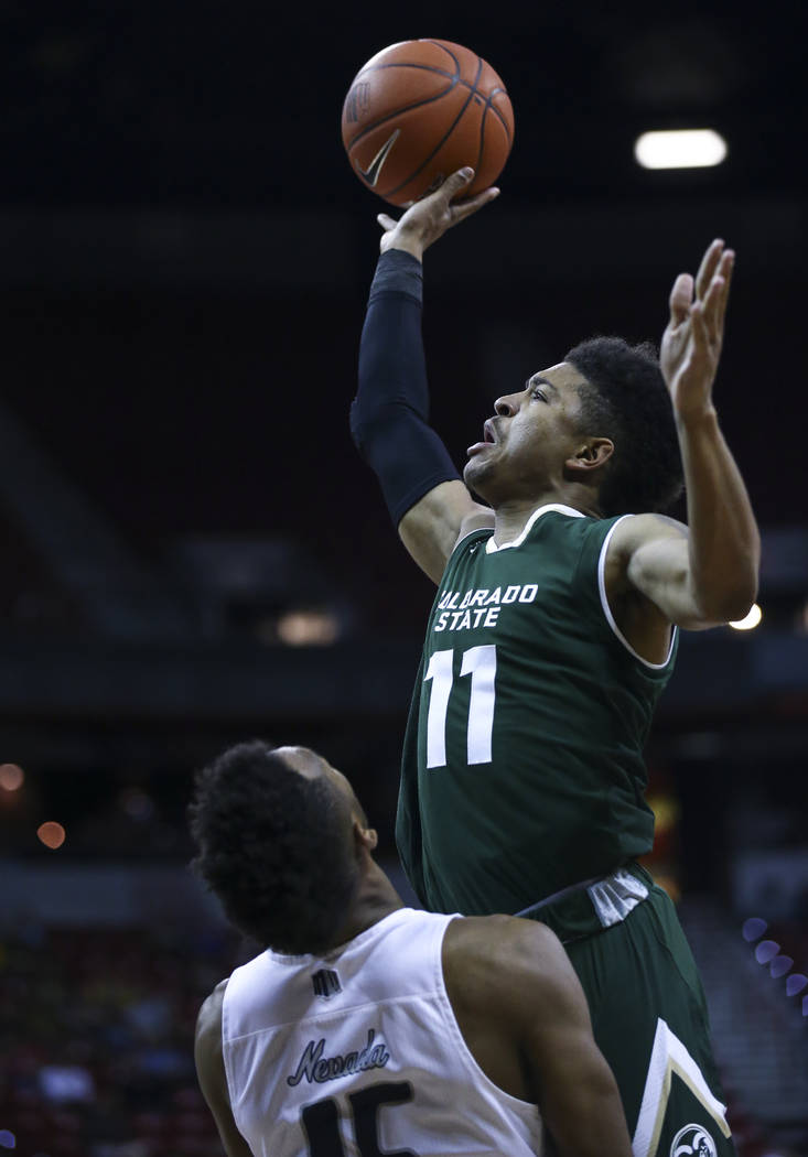 Colorado State guard Prentiss Nixon (11) shoots over UNR guard D.J. Fenner (15) during the Mountain West Conference basketball championship game at the Thomas & Mack Center in Las Vegas on Sat ...