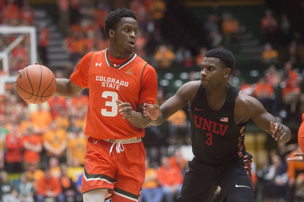 Colorado State guard Raquan Mitchell tries to get around UNLV guard Amauri Hardy during an NCAA college basketball game Saturday, Jan. 20, 2018, in Fort Collins, Colo. (Austin Humphreys/The Colora ...