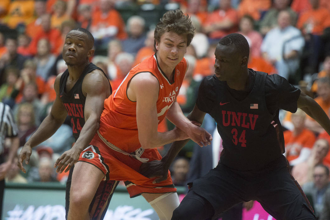 Colorado State forward Logan Ryan works to get around UNLV's Jordan Johnson, left, and Cheikh Mbacke Diong during an NCAA college basketball game Saturday, Jan. 20, 2018, in Fort Collins, Colo. (A ...