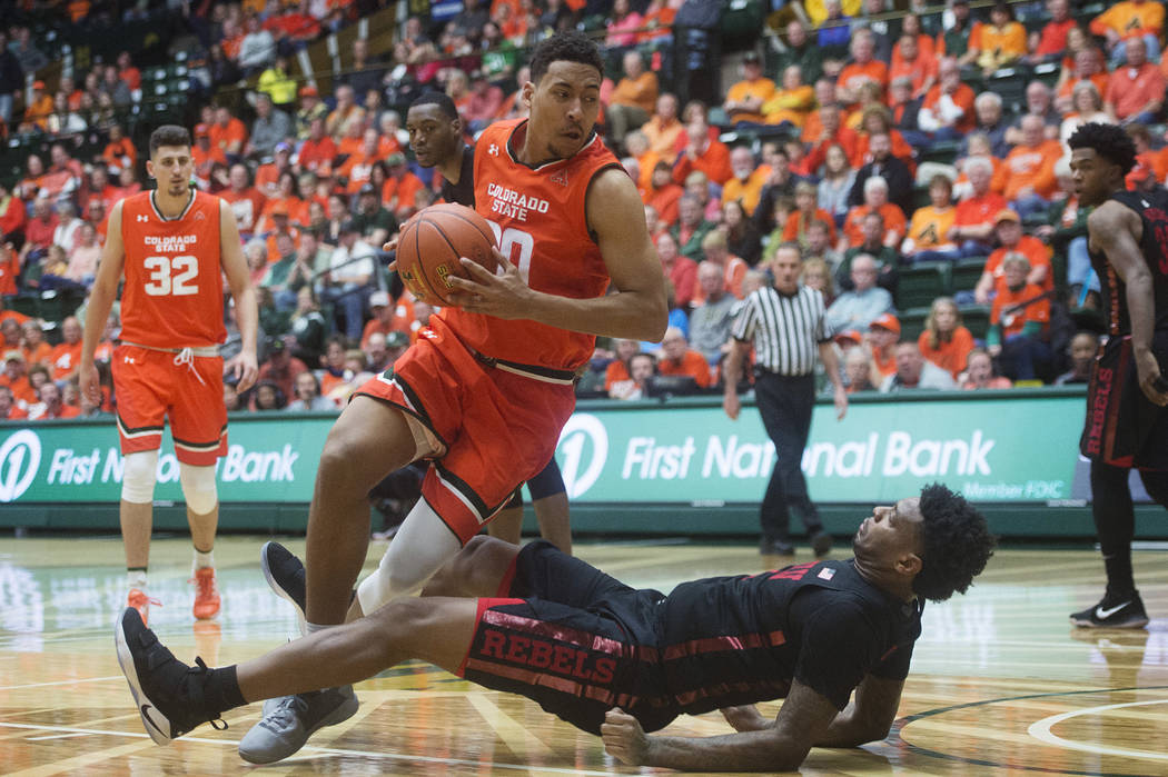 UNLV forward Tervell Beck falls to the court as Colorado State's Deion James drives during an NCAA college basketball game Saturday, Jan. 20, 2018, in Fort Collins, Colo. (Austin Humphreys/The Col ...
