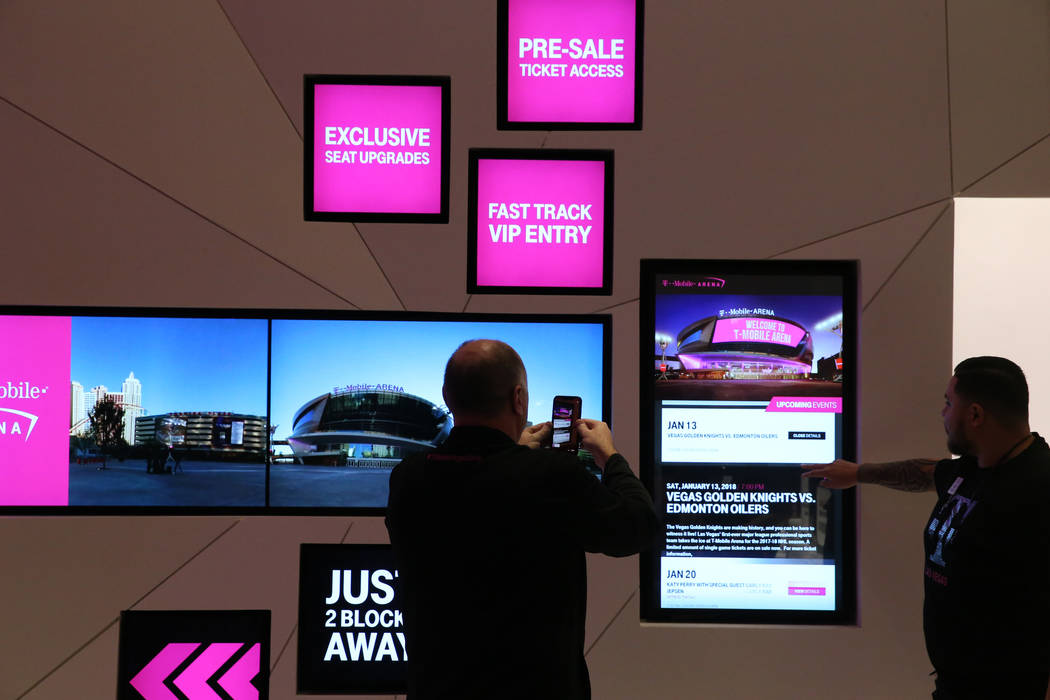 T-Mobile Executive Vice President for U.S. Sales and Operations Jon Freier, does a Periscope live broadcast on opening night of the nightclub-themed signature store on the Strip Thursday, Jan. 4,  ...