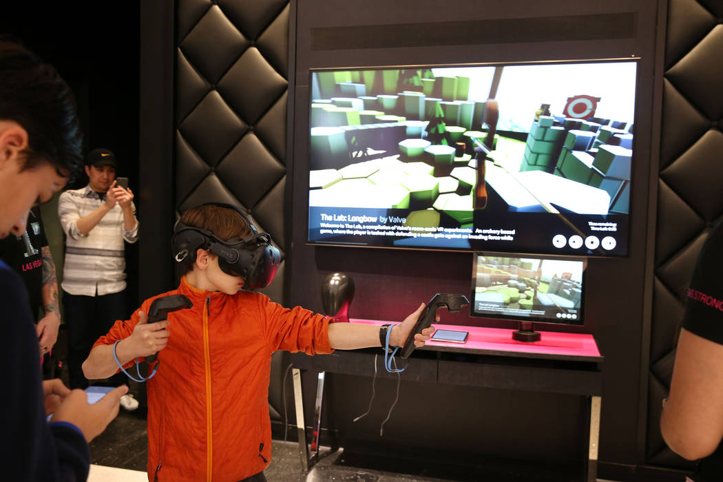 Tosha Babenko, 9, of Phoenix, plays a game at T-Mobile signature store on the Strip on opening night Thursday, Jan. 4, 2018. It is located inside the Showcase Mall, near the intersection of Las Ve ...