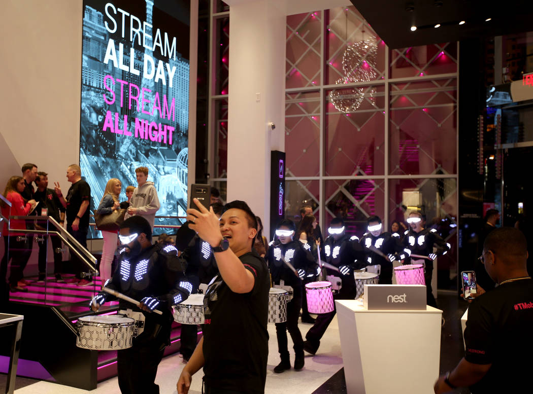 T-Mobile Signature Mobile Expert Lance Tran takes a selfie with a drum group on opening night of the nightclub-themed signature store on the Strip Thursday, Jan. 4, 2018. It is located inside the  ...