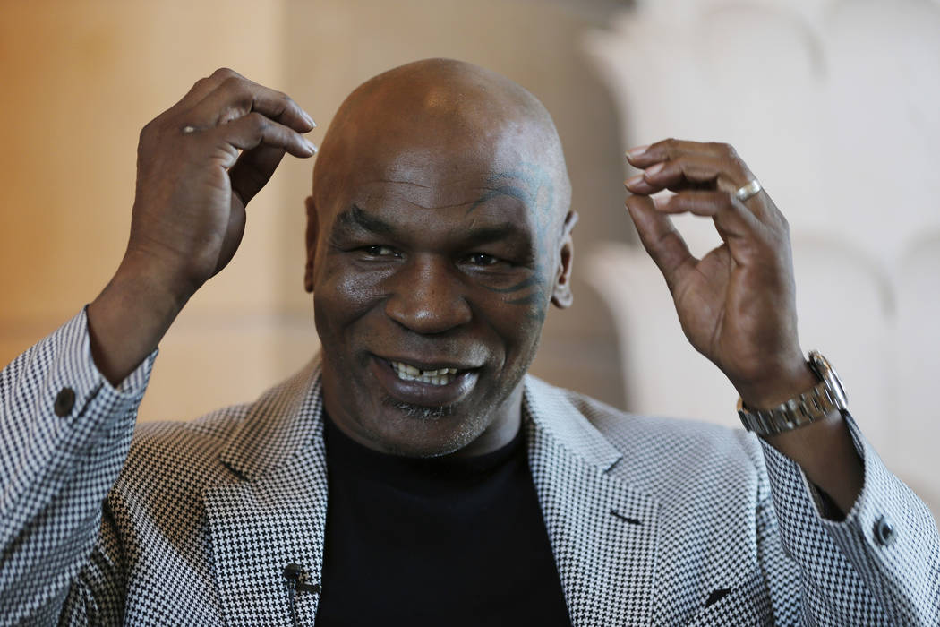 In this May 4, 2017 file photo, Mike Tyson speaks during an interview with The Associated Press, in Dubai, United Arab Emirates. Former heavyweight champion Tyson is becoming a California marijuan ...