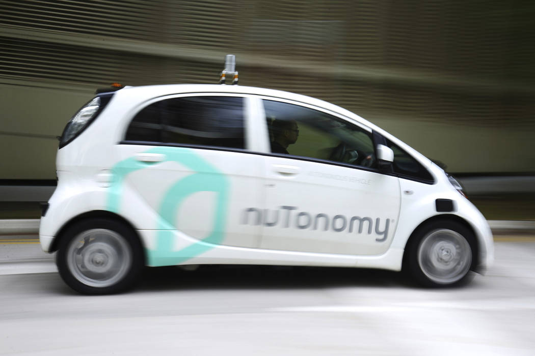 A nuTonomy autonomous vehicle is driven during its test drive in Singapore on Wednesday, Aug. 24, 2016. Lyft and its Boston-based partner nuTonomy, which builds autonomous software, announced Wedn ...