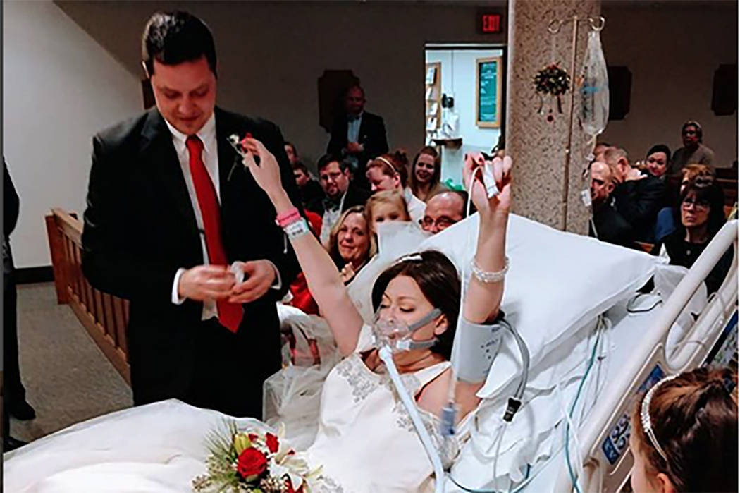 "An Instagram photo shows Heather Mosher raising both arms in the air as she and David Mosher said ""I do"" Dec. 22 at St. Francis Hospital and Medical Center in Hartford, Conn. (christina.lee.ph ..."