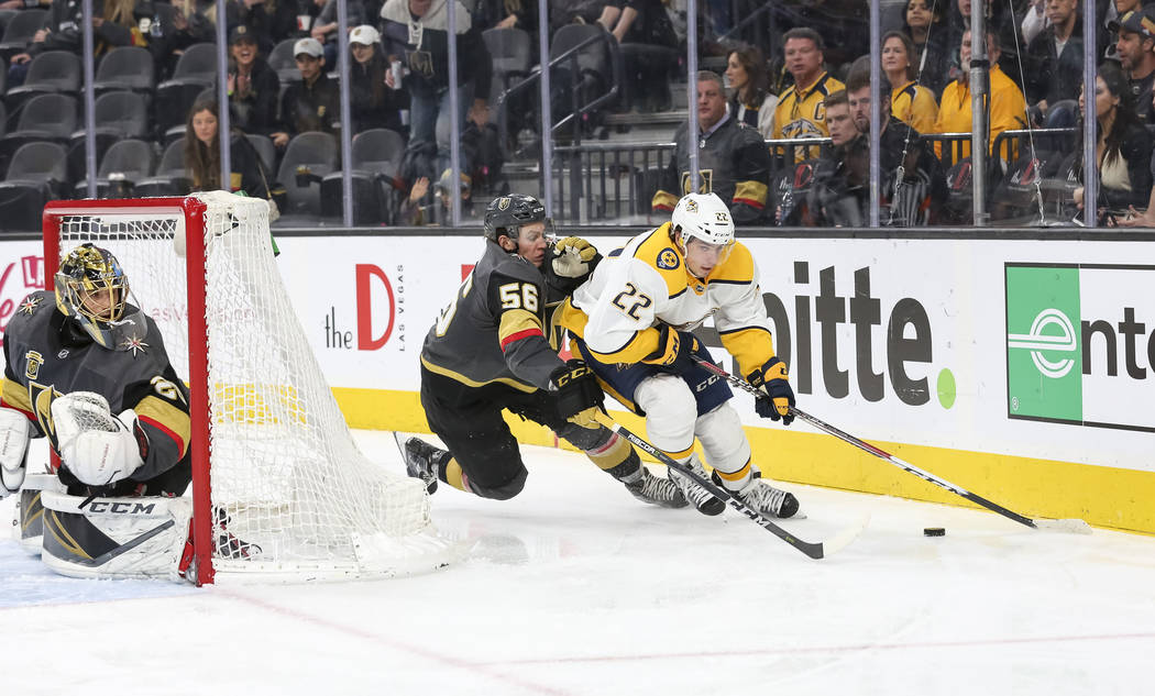 Nashville Predators left wing Kevin Fiala (22) is pressured by Vegas Golden Knights left wing Erik Haula (56) as Knights goaltender Marc-Andre Fleury protects his net during the second period of a ...