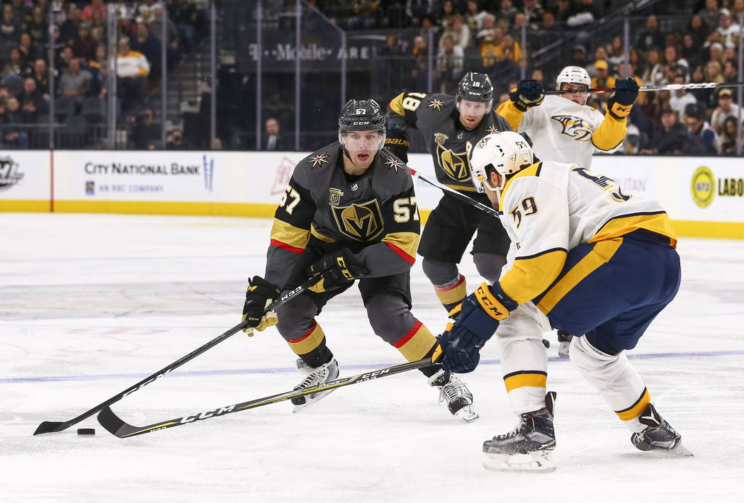 Vegas Golden Knights left wing David Perron (57) controls the puck against Nashville Predators defenseman Roman Josi (59) during the third period of an NHL hockey game between the Vegas Golden Kni ...