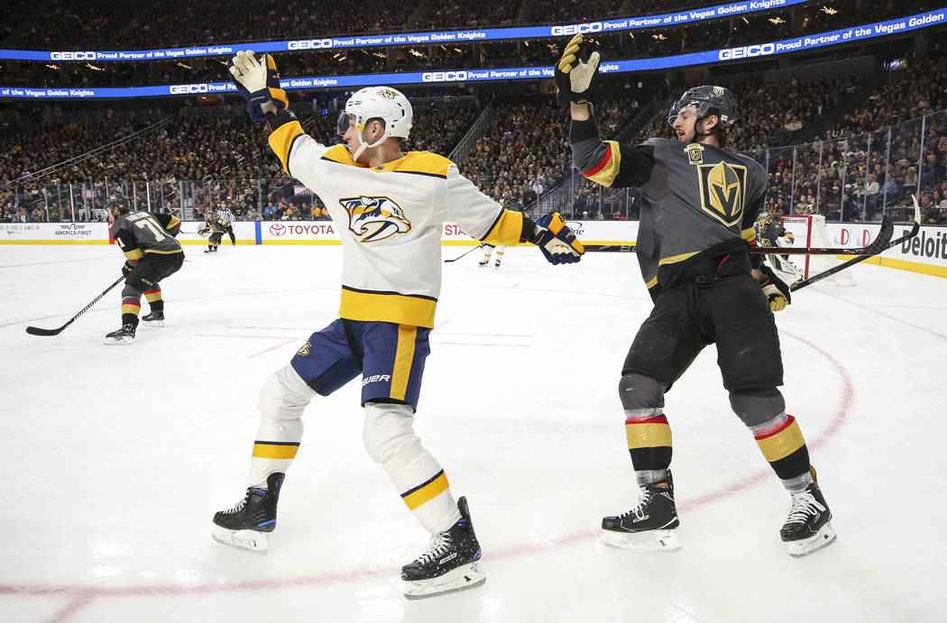 Nashville Predators center Kyle Turris (8) and Vegas Golden Knights defenseman Colin Miller (6) on the ice during the second period of an NHL hockey game between the Vegas Golden Knights and the N ...