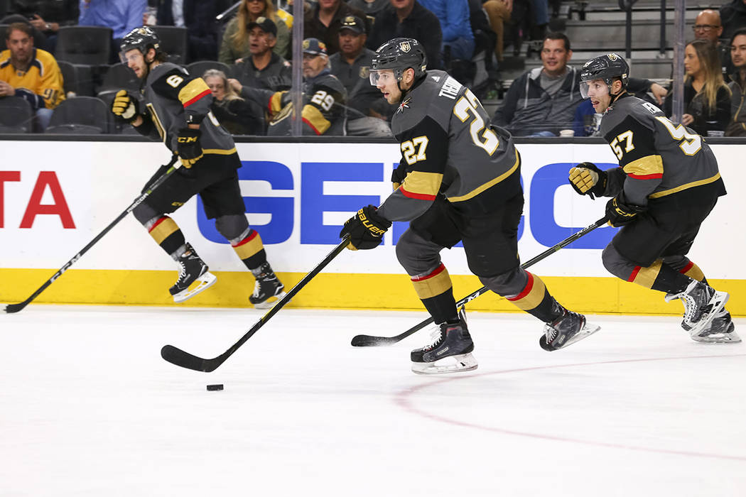 Vegas Golden Knights' Colin Miller, from left, Shea Theodore (27) and David Perron (57) on the attack during the second period of an NHL hockey game against the Nashville Predators at the T-Mobile ...