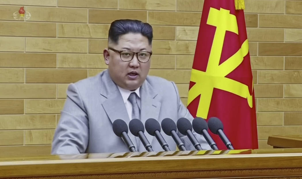 In this image made from video released by KRT on Jan. 1, 2018,  North Korean leader Kim Jong Un speaks in his annual address in undisclosed location, North Korea.  North Korean leader Kim said Mon ...