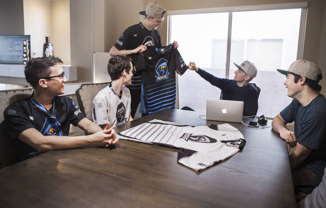 Rogue team members Brian Thomas, left, Colin Wentworth, Sean Mulryan, Andrew Stickney, Derek Nelson and Sean Mulryan take a look at the Las Vegas-based eSports team's newest jersey during a meetin ...
