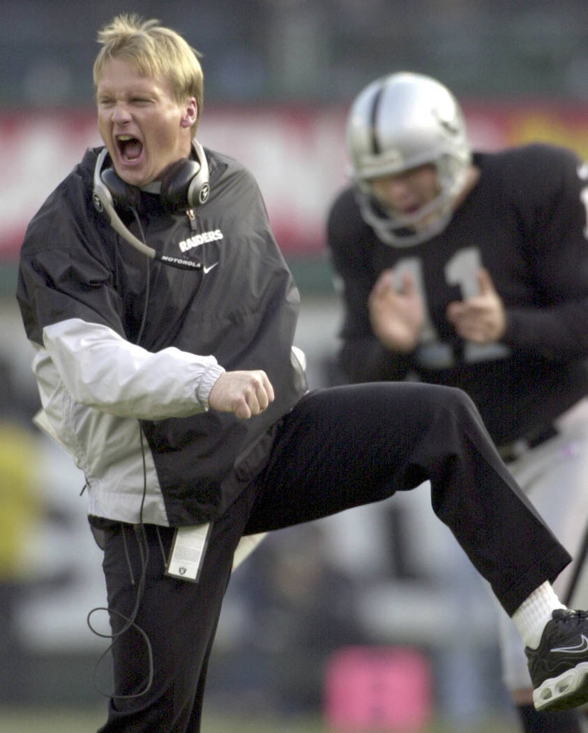 Oakland Raiders coach Jon Gruden and kicker Sebastian Janikowski (11) celebrate the Raiders' 27-0 win over the Miami Dolphins during the final moments of the AFC divisional playoff game at the Net ...