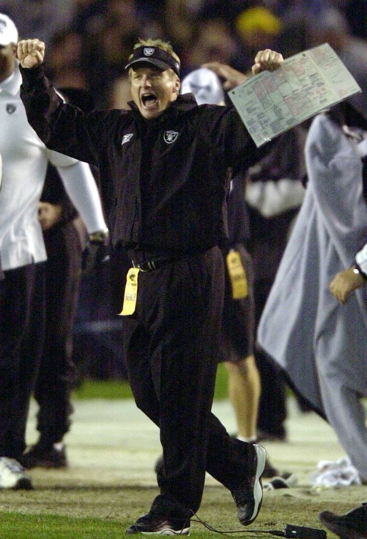 Oakland Raiders coach Jon Gruden celebrates as the Raiders run out the clock to clinch the AFC West championship with a 13-6 victory over the San Diego Chargers, Saturday, Dec. 15, 2001, in San Di ...