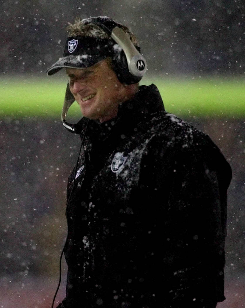 Oakland Raiders head coach Jon Gruden smiles during the first half at the AFC Divisional Playoff game against the New England Patriots at Foxboro Stadium, in Foxboro, Mass., Saturday Jan. 19, 2002 ...