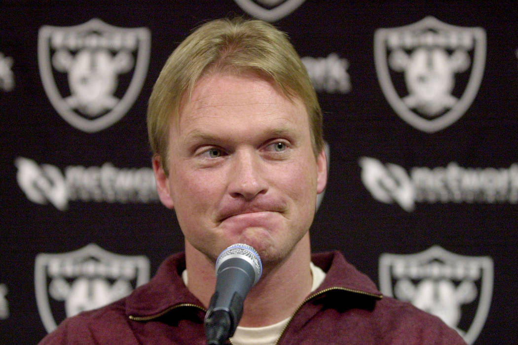 Oakland Raiders coach Jon Gruden pauses during a news conference at Raiders headquarters in Alameda, Calif., Monday, Jan. 21, 2002. (AP Photo/Paul Sakuma)