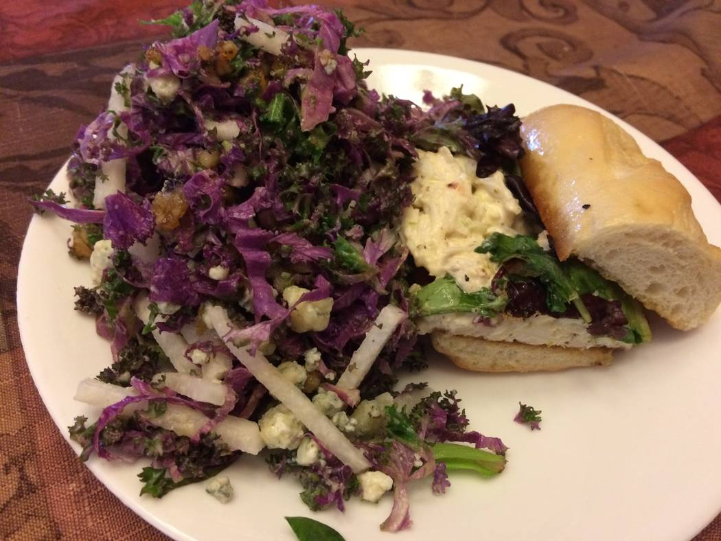 Kitchen Table's crab po boy is plated with kale salad,  seen Jan. 2, 2018. (Jan Hogan/View)