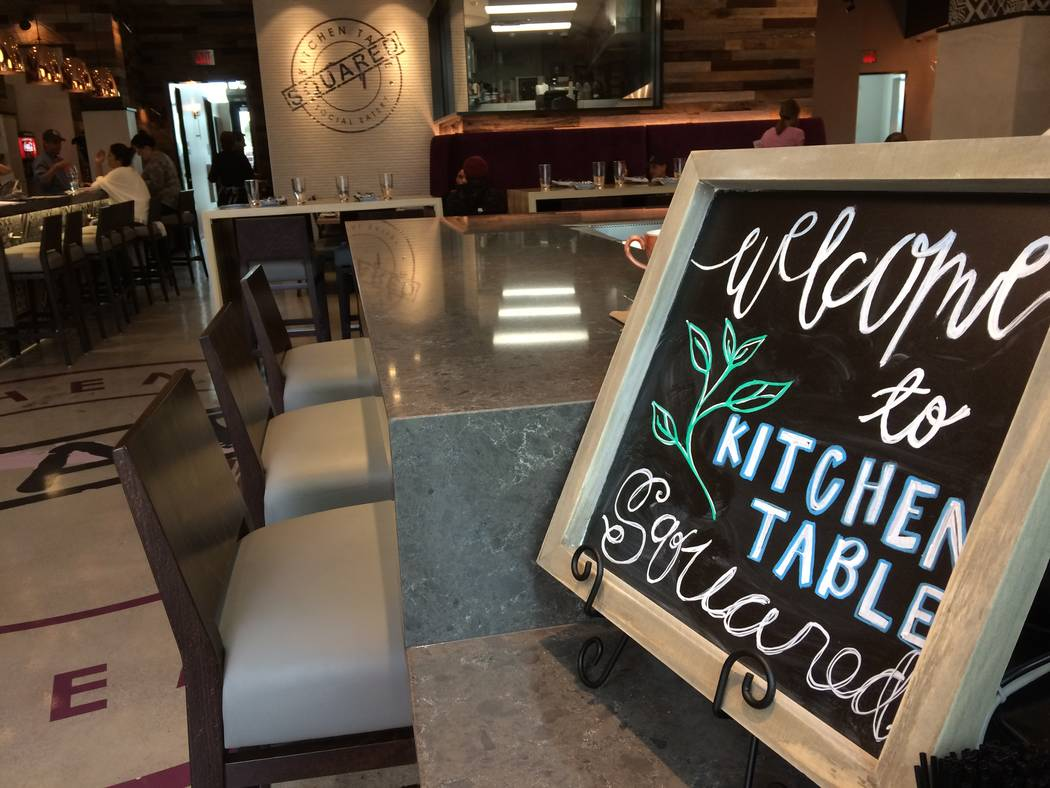 A sign greets patrons to Kitchen Table's interior Jan. 2, 2018. Chef Javier Chavez based the concept on his upbringing, where everything - homework, conversation, games - happened at the family ta ...