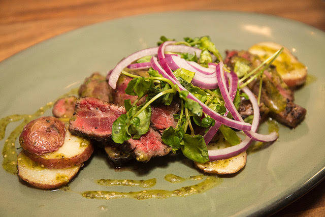 Marinated Flank Steak in garlic, cilantro, jalapeno, beer, roasted red bliss potatoes, salsa verde