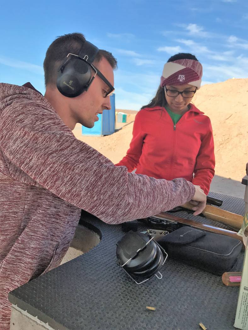 Dallin Nielsen teaches his bride how to safely load and fire his .22 caliber shooting rifle. This was Stephanie's first-ever experience with firearms. (Doug Nielsen)