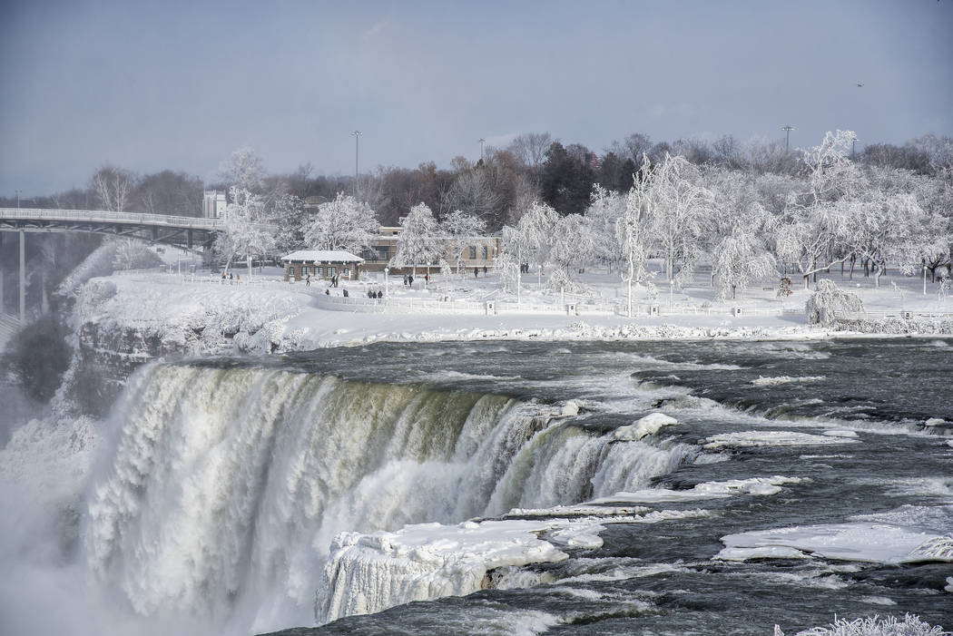 A frozen Niagara Falls is seen in views from Stedman's Bluff on Goat Island of the American Falls and Prospect Point beyond. Almost every year frigid temperatures transform Niagara Falls State Par ...