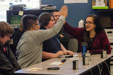 Students high-five  during practice for quiz bowl at the Liberty High School in this photo from 2017.  (HSNCT/SPECIAL)