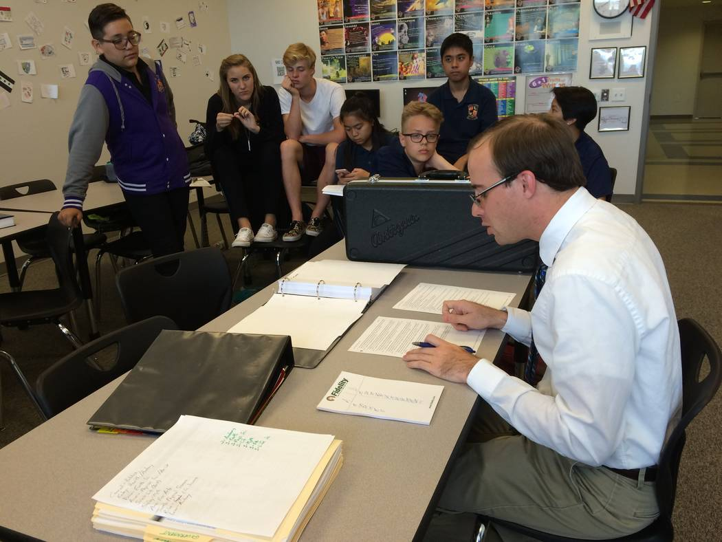 Doral Academy teacher in Matt Albert conducts an after-school quiz club session Sept. 8, 2016. Albert was a member of his high school's quiz bowl team and said Clark Country's version does not ...