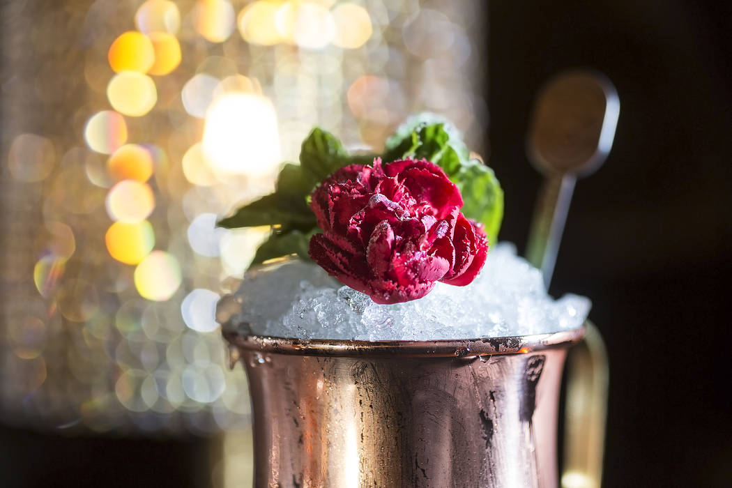 The Banco de Mexico with Crème de Cacao, Mezcal, Anejo tequila, fresh mint sprigs, rose water mist and powdered sugar at Rosina on Tuesday, January 2, 2017, at The Palazzo hotel-casino, in La ...