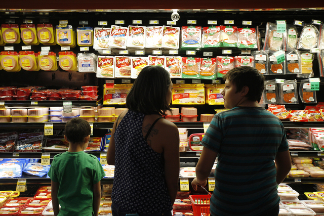 Evan Maness, 7, his mom Karina Gonzalez, and his brother Ethan Maness, 11, shop for lunch meat on Monday, Nov. 14, 2016, at Glazier Food Marketplace in Las Vegas. Rachel Aston/Las Vegas Review-Jou ...