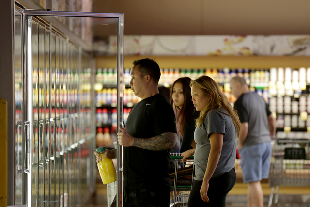 David Singkum shops for groceries with his wife Jerika on Monday, Nov. 14, 2016, at Glazier Food Marketplace in Las Vegas. Rachel Aston/Las Vegas Review-Journal Follow @rookie__rae