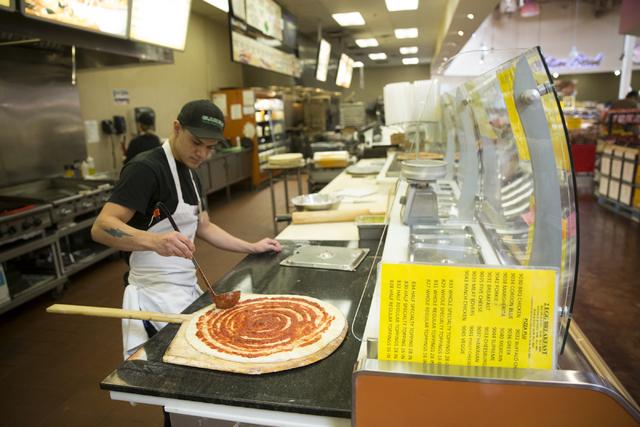 Chris Vindell prepares a pizza at Glazier's food marketplace on Thursday, Nov. 10, 2016, in Las Vegas. Erik Verduzco/Las Vegas Review-Journal Follow @Erik_Verduzco